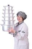 Cocinero con la pila de potes fotografía de archivo