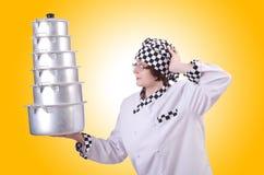 Cocinero con la pila de potes Imagen de archivo libre de regalías