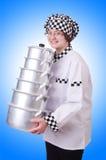 Cocinero con la pila de potes imágenes de archivo libres de regalías
