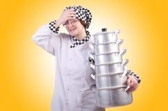 Cocinero con la pila de potes foto de archivo libre de regalías
