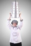 Cocinero con la pila de potes en blanco Foto de archivo libre de regalías