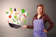 Cocinero con las verduras dibujadas coloridas fotos de archivo libres de regalías
