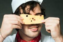 Cocinero con queso Imagenes de archivo