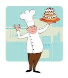 Cocinero con una torta Foto de archivo