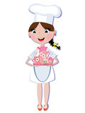 Cocinero de la muchacha con el conjunto de té Fotos de archivo libres de regalías