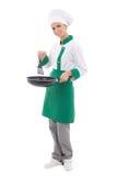 Cocinero de la mujer en el sartén que se sostiene uniforme - integral aislado Fotos de archivo