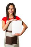 Cocinero de la mujer en sombrero del cocinero con el tablero en blanco, en blanco Imagenes de archivo
