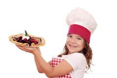 Cocinero de la niña con crespones Foto de archivo