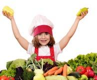 Cocinero de la niña con pimientas Foto de archivo libre de regalías