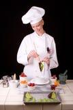 Cocinero de pasteles con la hoja Imagen de archivo libre de regalías