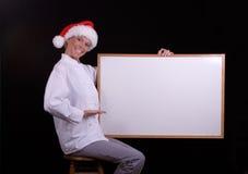 Cocinero de Santa con la tarjeta blanca Imagenes de archivo