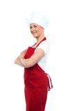 Cocinero de sexo femenino confiado alegre imagenes de archivo