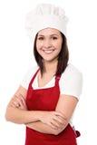 Cocinero de sexo femenino joven confiado alegre Foto de archivo