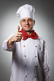 Cocinero de sexo masculino con el pulgar encima del retrato Imagen de archivo libre de regalías