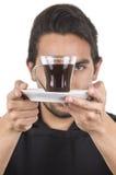 Cocinero de sexo masculino joven hermoso que lleva el delantal negro Imágenes de archivo libres de regalías