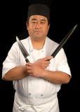 Cocinero de sushi asiático con sus cuchillos Imágenes de archivo libres de regalías