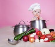 Cocinero del bebé Fotos de archivo libres de regalías