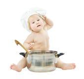 Cocinero del bebé en sombrero del cocinero con el crisol grande Imágenes de archivo libres de regalías