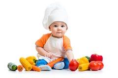 Cocinero del bebé con la comida sana Foto de archivo libre de regalías