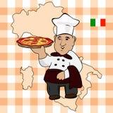 Cocinero del cocinero con la pizza en la placa Fotos de archivo libres de regalías