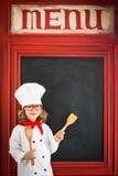 Cocinero del cocinero del niño Concepto del negocio de restaurante Imagenes de archivo