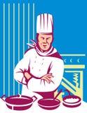 Cocinero del cocinero que cocina una comida Foto de archivo libre de regalías
