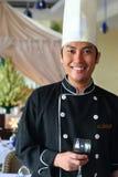 cocinero ejecutivo y vino rojo Fotos de archivo libres de regalías