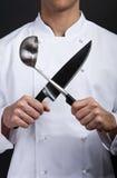 Cocinero emocional con el cuchillo y la bifurcación Fotos de archivo libres de regalías