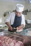 Cocinero en el carnicero Imagen de archivo libre de regalías