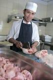 Cocinero en el carnicero Imagenes de archivo
