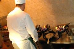 Cocinero en el trabajo Imágenes de archivo libres de regalías