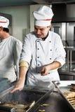 Cocinero en el trabajo fotografía de archivo libre de regalías