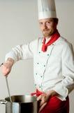 Cocinero en el trabajo Imagenes de archivo