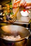Cocinero en la acción Imagen de archivo libre de regalías