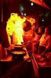 Cocinero en la acción Fotos de archivo