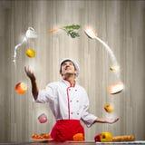 Cocinero en la cocina Imagen de archivo libre de regalías