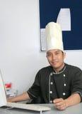 Cocinero en oficina imagenes de archivo