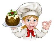 Cocinero Holding Christmas Pudding de la mujer ilustración del vector