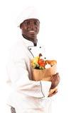 Cocinero Holding Groceries fotos de archivo libres de regalías
