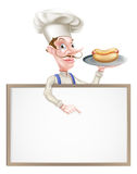Cocinero Holding Hotdog Pointing de la historieta en la muestra Fotos de archivo libres de regalías