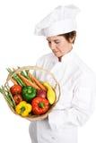 Cocinero Inspecting Produce Foto de archivo libre de regalías
