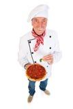 Cocinero italiano con la pizza Foto de archivo libre de regalías