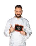 Cocinero joven con la pizarra imagen de archivo