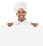 Cocinero que lleva a cabo una muestra en blanco Imagen de archivo libre de regalías