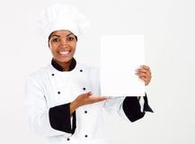 Cocinero que presenta el menú Fotografía de archivo libre de regalías