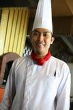 Cocinero que presenta en el trabajo Imágenes de archivo libres de regalías