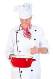 Cocinero que revuelve adentro la cacerola Imágenes de archivo libres de regalías