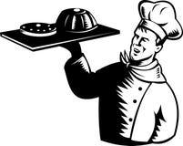 Cocinero que sirve una bandeja de pasteles Imagen de archivo libre de regalías