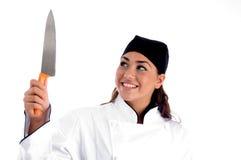 Cocinero sonriente con el cuchillo Foto de archivo libre de regalías