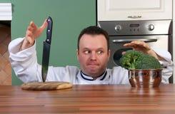 Cocinero y bróculi Fotografía de archivo